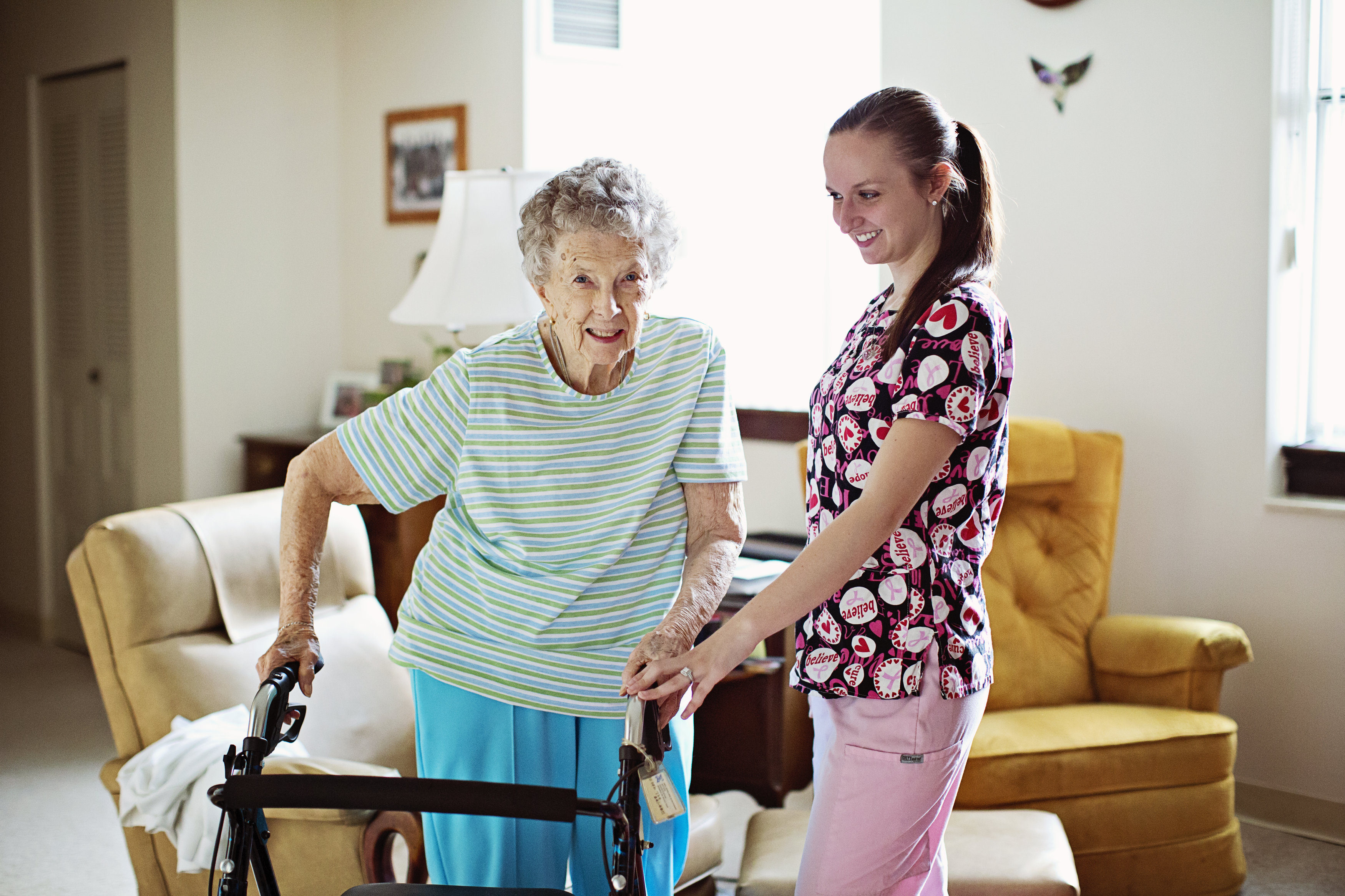 Home Health Aide worker taking care of elderly patient