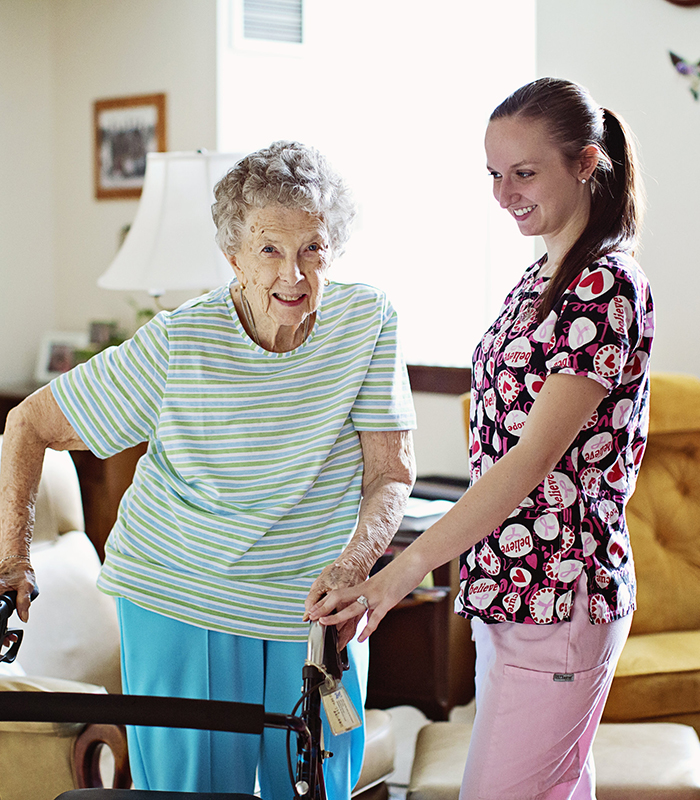 Home Health Care Aide with elderly patient with walker.